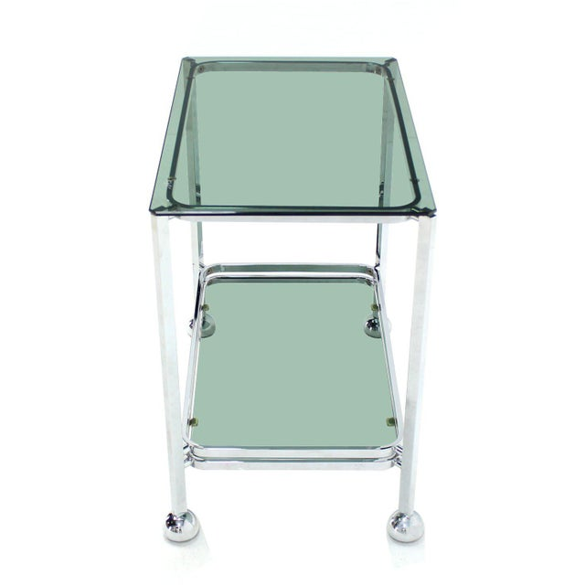 Hollywood Regency Chrome Tinted Smoked Glass Rolling Tea Cart With Concealed Wheels For Sale - Image 3 of 7