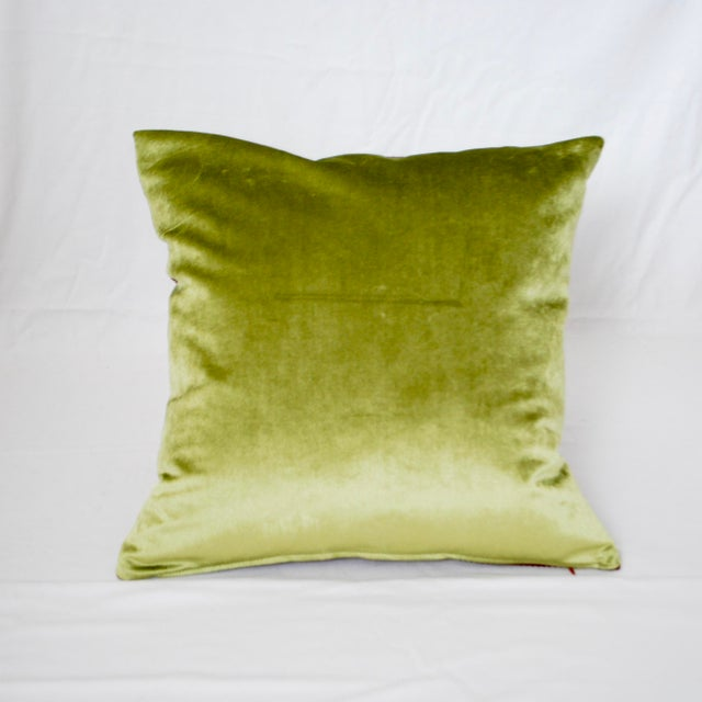 An original design, this pillow marries African fabric from a Brooklyn thrift store and Rabati-style embroidery from...