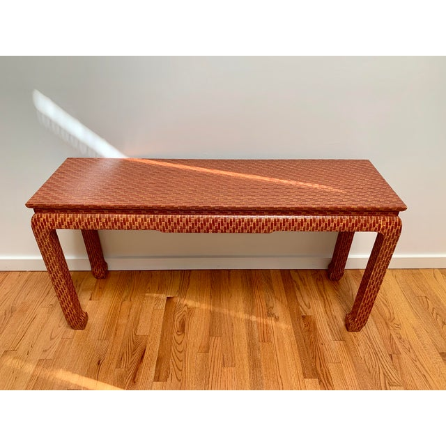 Stunning Karl Springer style Asian style console table covered in lacquered orange and red brick patterned fabric from...