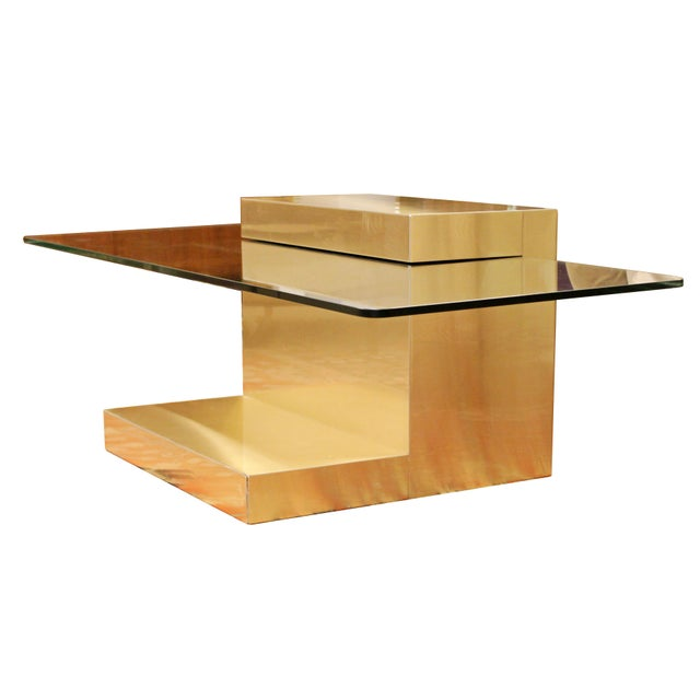 For your consideration is a phenomenal, cantilever, brass coffee table with a set in glass top, by Paul Evans, circa the...