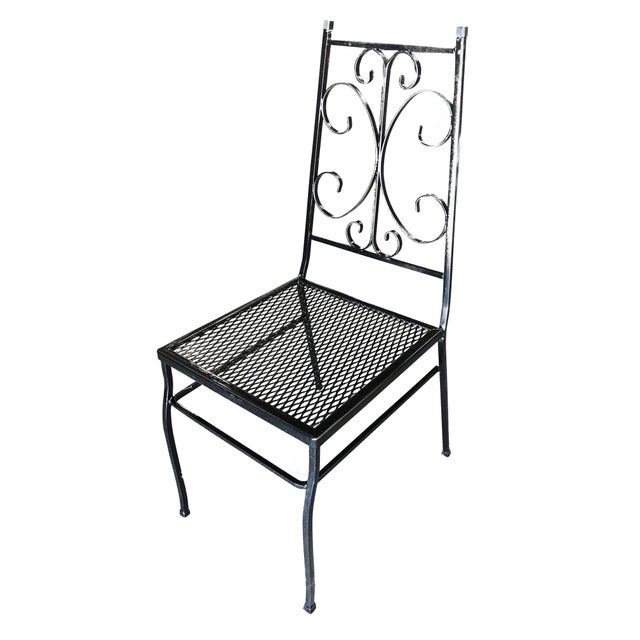 Set of four outdoor patio chairs with scrolling pattern and mesh steel seats. Please inquire us if you would like a...