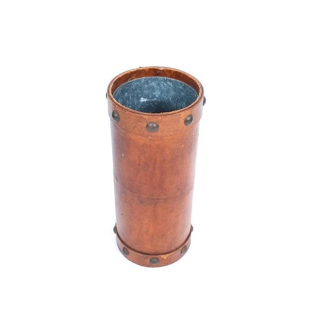 "Nicely sized 21"" leather umbrella stand made in France, circa 1950. It shows some wear and staining and comes with a steel..."