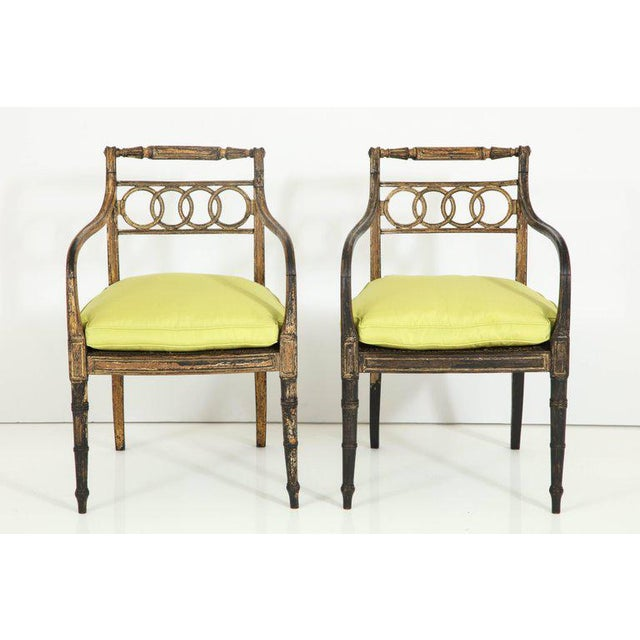 The detail and finish of these two chairs make them exceptional. Painted black with gold leaf accents, the chairs are...