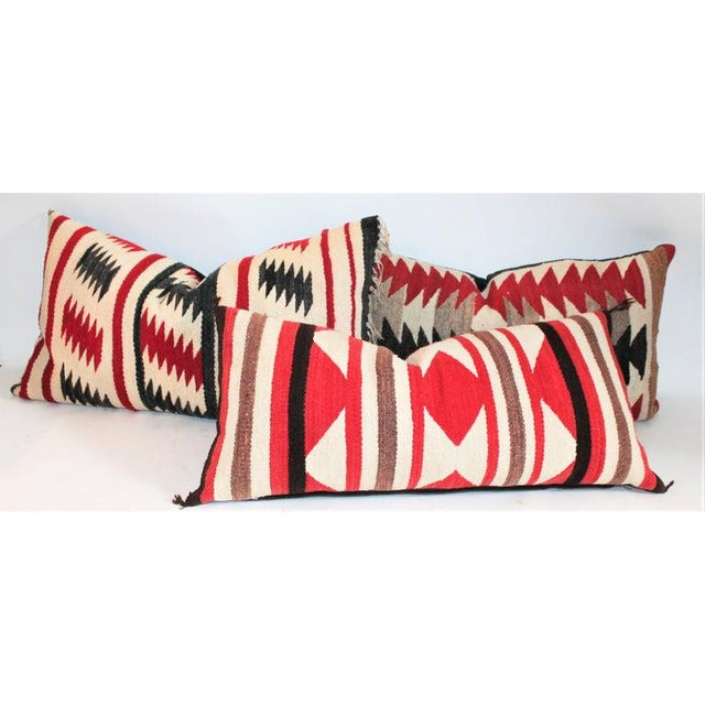 These three Navajo Indian weaving pillows are made from saddle blankets. The condition are all very good with cotton linen...
