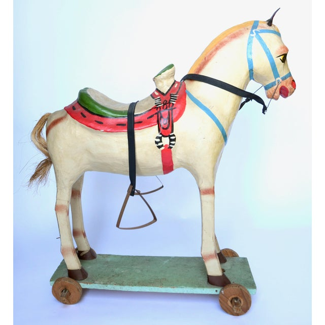 "A wonderful and rare large Mexican Folk Art paper mache wood pull horse on wheels. Love the size, 27"" H."