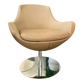 Vintage Mid Century Tan Swiveling Armchair on Chrome Base For Sale