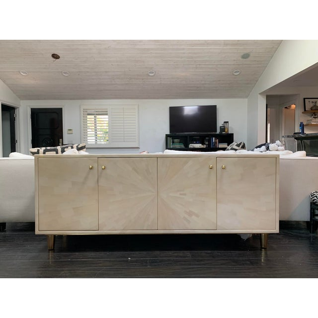 Stunning four door Torion buffet / sideboard from Made Goods. Featured in ivory, the faux horn boasts a starburst pattern...