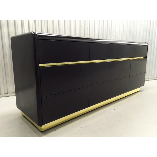 A beautiful black and brass gold trim nine drawer dresser by Lane. Newly lacquered. Plenty of storage with nine drawers...