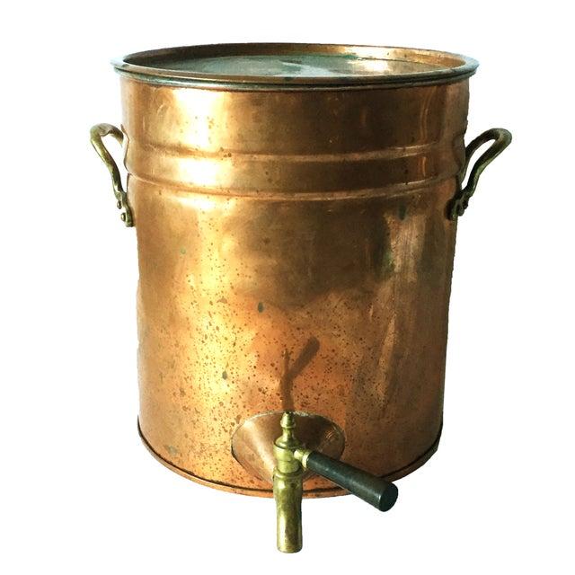 Antique copper drink dispenser with brass handles and spigot. Tap on spigot is ebonized wood. Circa 1900-1910. Water spots...