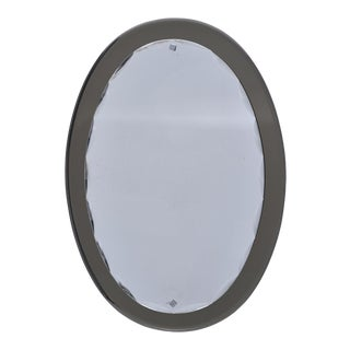 Pair Fontana Arte Oval Mirrors With Taupe Base and Scalloped Beveled Frame For Sale