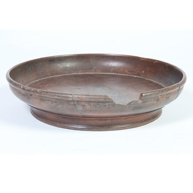 An Indonesian teak wooden serving tray with a small-sized damage on the rim.