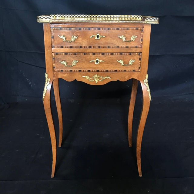 Sumptuous French Louis XV style walnut inlaid night stand or side table having two dovetailed drawers above a carved apron...