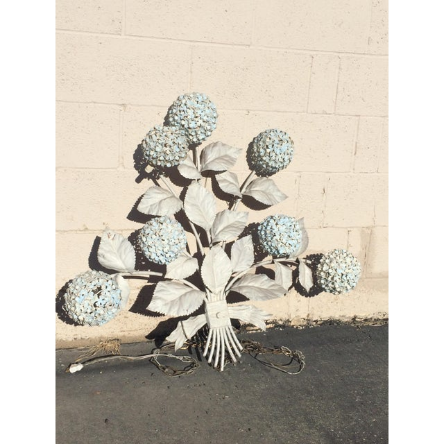 Mid Century Hydranga Metal Wall Light that is still in working condition! This light has 7 large hydrangea lights...