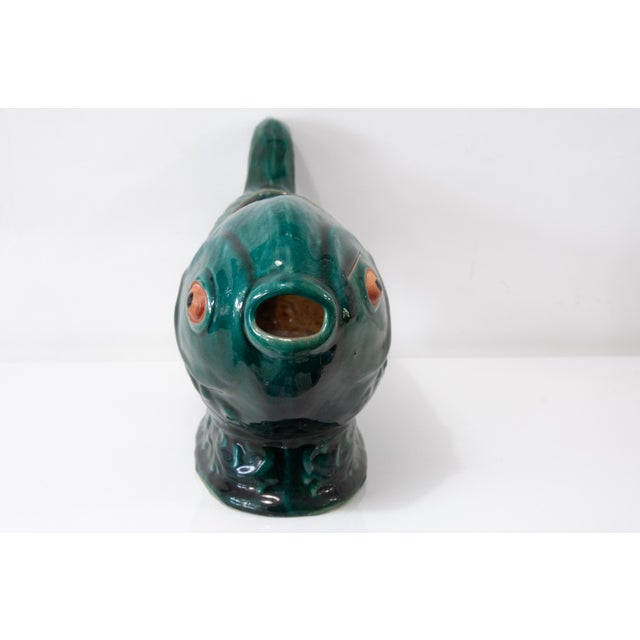 One-of-a-kind ceramic, hand painted, decorative fish, with interesting markings and texture. Great looking on a stack of...