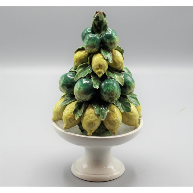 A mid century Italian hand molded and hand painted fruit topiary with limes and lemons. It is beautifully modeled with...