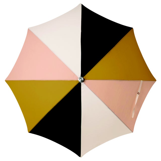 """""""The umbrella that is as versatile as it is beautiful, built for the beach in the morning and put back up on the deck in..."""