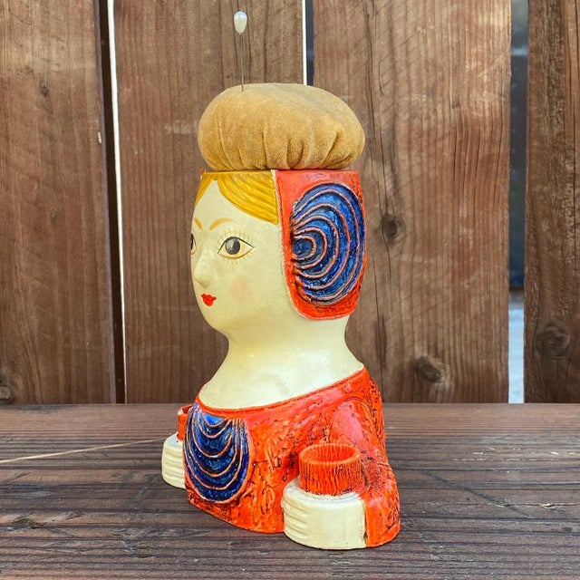 This brightly colored doll is made of paper mache, coated and painted all by hand by the infamous paper artist Gemma...