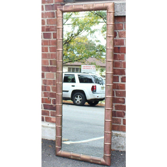 Metal rectangular faux bamboo wall mirror. Made in the mid 20th century.