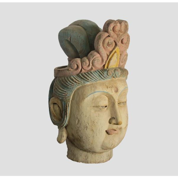 This sculpture of Guan Yin head was rescued from a collapsing temple. It was beautifully carved with the faded polychrome...