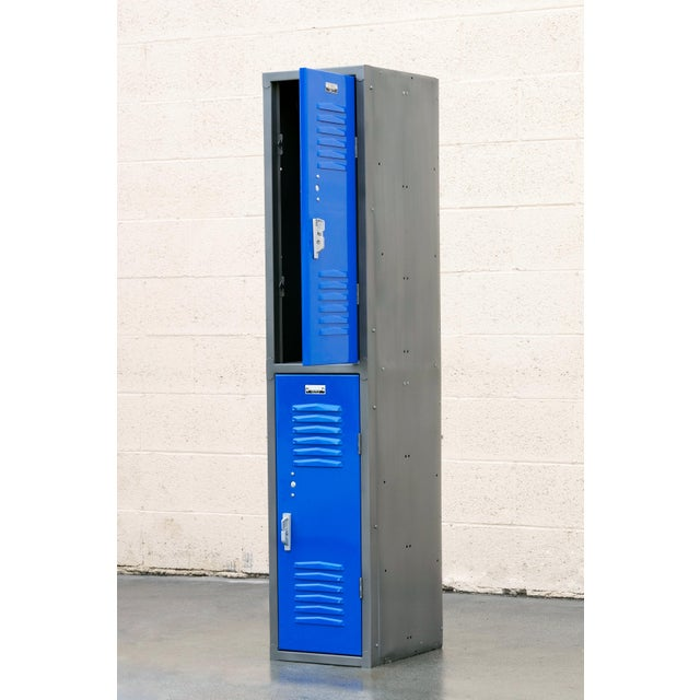 1970s all-American locker unit refinished in Natural Steel and Royal Blue (BL01) powder coat. Stacked, double door...