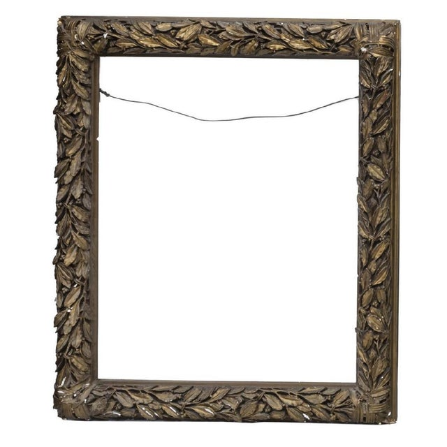 "Antique gold gilt wood frames. One frame with molded laurel leaf motif. sight: approx 38.25""h, 30.75""w overall: approx..."