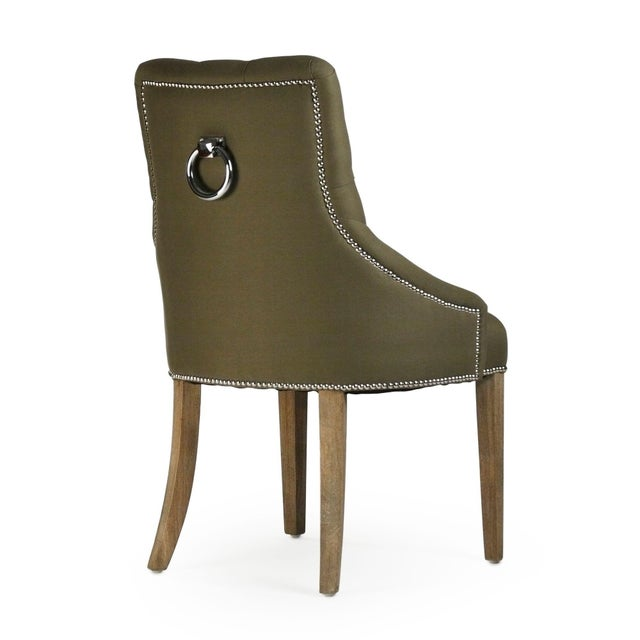 Tufted side chair upholstered in green cotton/linen on limed grey oak frame.