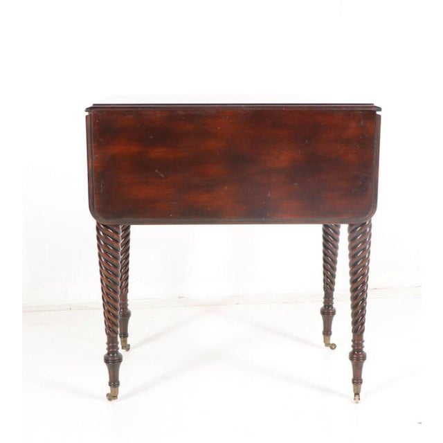 Offering an absolutely beautiful mahogany, barley twist, drop leaf table by Matiland-Smith. The beautiful lines of this...