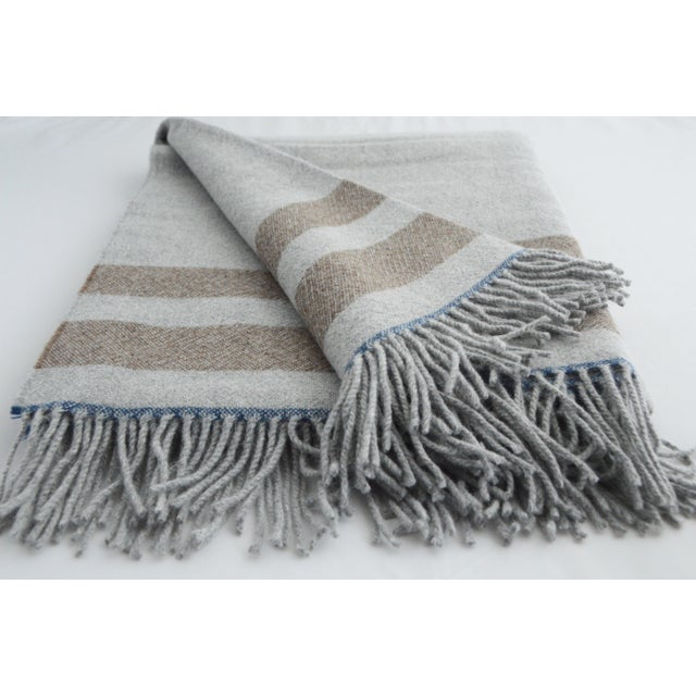 This gorgeous throw is made of luxurious alpaca, it is incredibly soft and warm. The colors are elegant and bright and...
