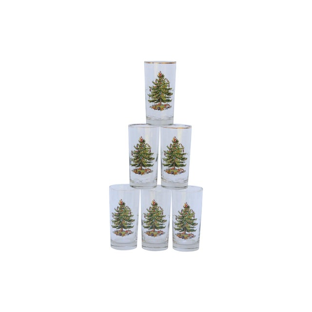 A set of six hi-ball glasses printed with vintage decorated Christmas Trees. Tops are lightly rimmed in gold. Dimensions...