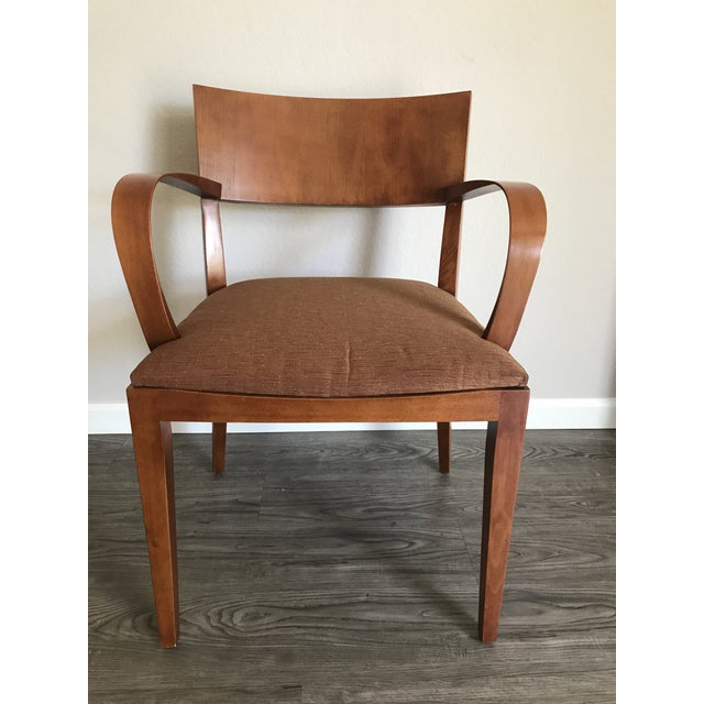 A set of four dining/side chairs designed by Jonathan Crinion for Knoll in 1999. All four have the ribbon-band arms and...