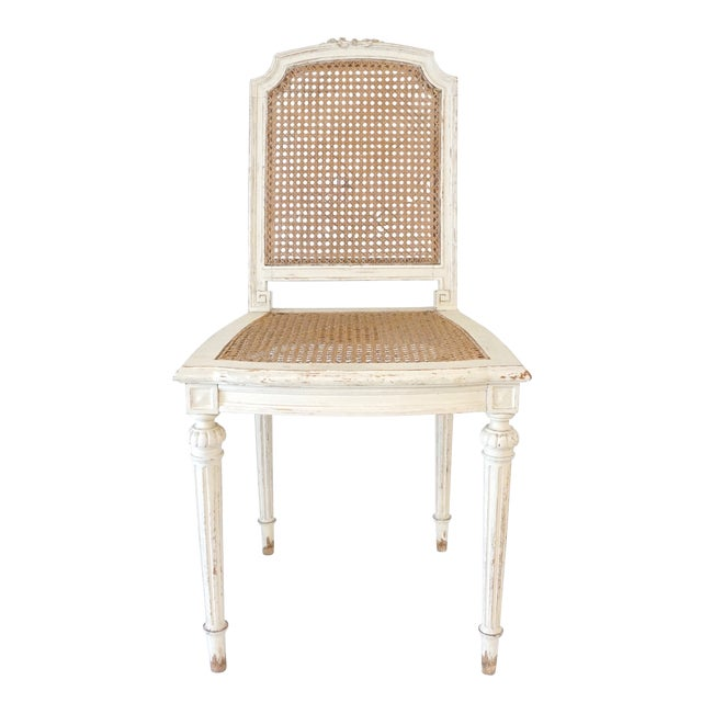 Charming Louis XVI carved white wood and caned chairs. 19D x 17 1/2W x 35H