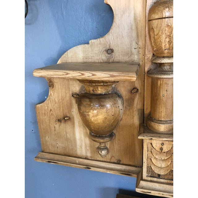 A beautiful natural carved wood Swedish mirror, probably originally the top part of a dresser commode, having shell shape...