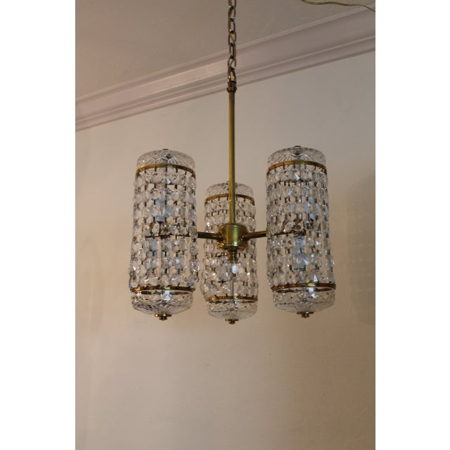 A rare model, stunning authentic, signed mid century crystal chandelier by Waterford, c1960's. This beauty is extra...