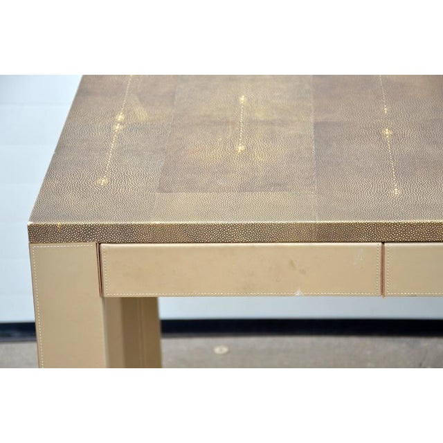 Three drawers, could be used as desk, console or a table. Taupe leather wrapped base.
