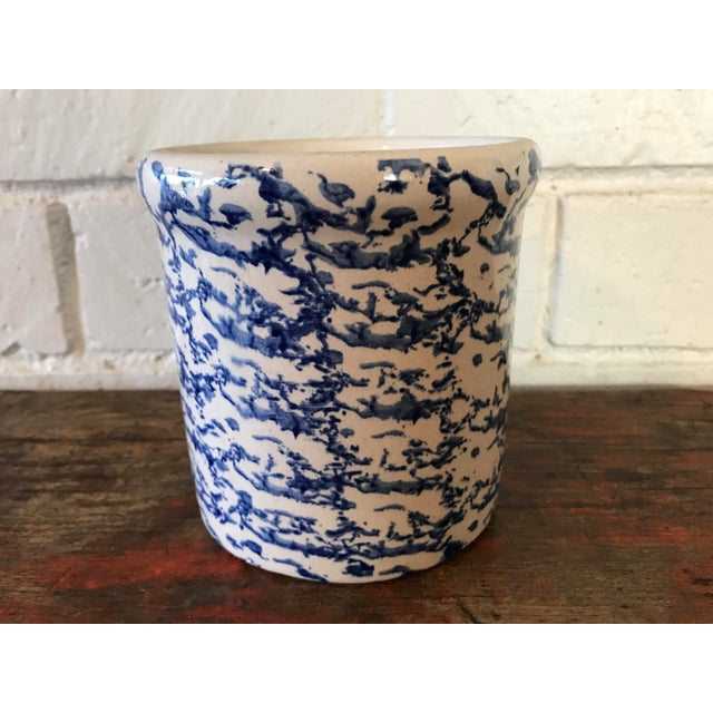 Vintage stoneware crock with a blue sponge ware pattern glaze. This would make a great utensil holder. In great condition....