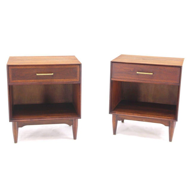 Pair of very nice mid-century modern walnut end tables with brass pulls.