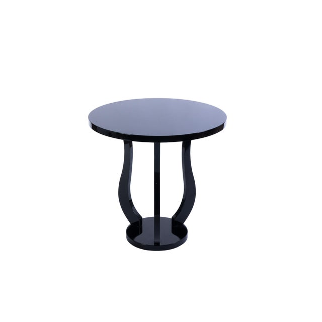 This gorgeous French Art Deco round side table features a tulip shape design in piano black lacquer. Made in France Circa:...