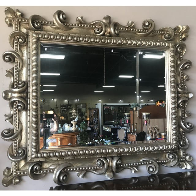 With a wooden frame intricately carved and covered entirely in gold leaf, this mirror is a unique treasure. Custom made in...