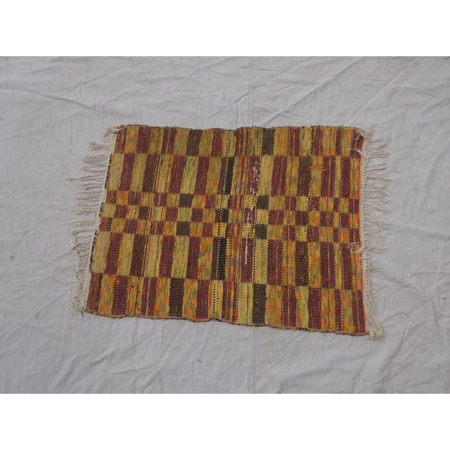 This is an antique hand woven Swedish rag rug.
