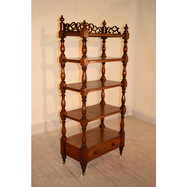19th century English mahogany etagere with wonderful fretwork around the top shelf, decorated with finials, following down...