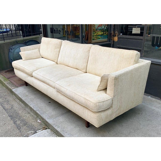This spacious Dunbar sofa features deep upholstered seats with a plush vintage chenille fabric. The cutaway armrests and...