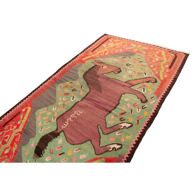 Rug & Kilim exclusive donkey rug is full of color and whimsy. A wonderful assortment of brown, green, red, pink and yellow...