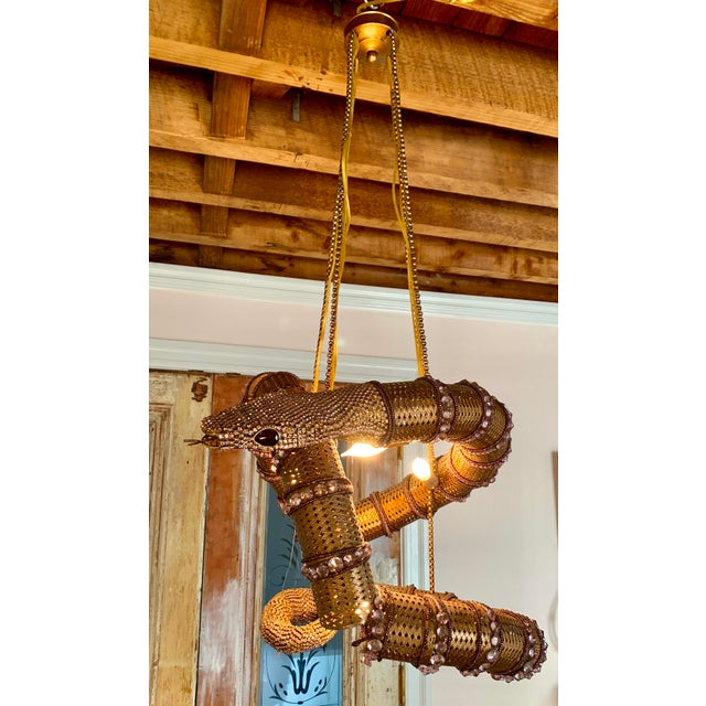 Stunning Serpent Chandelier. Golden metal and pink stones, i believe this is a handmade piece by an artist. I had bought...