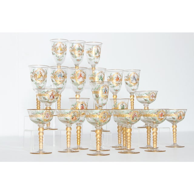 A set of Venetian glass stemware with poly chrome Florentine enamel decoration, a central gold cartouche bearing either a...