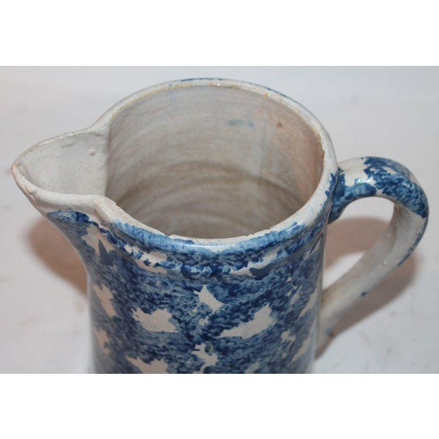 This 19th century sponge pitcher is in good condition with minor wear on base.