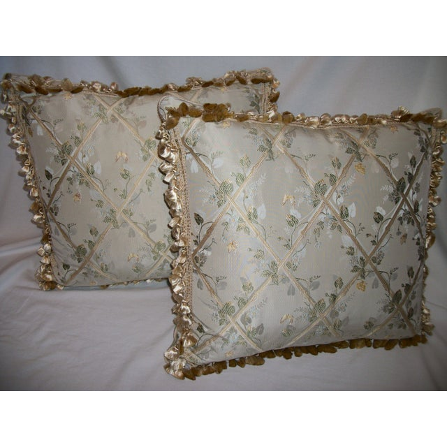 """An exquisite pair of Scalamandre custom designer pillows in the """"Butterfly & Trellis"""" pattern in silk lampas. The pillows..."""