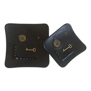 Mid-Century Modern Dada Matte Black Decorative Ceramic Wall Plates - A Pair For Sale