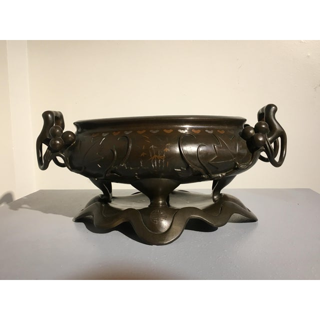 A beautifully shaped Chinese bronze jardiniere or planter, originally made for use as an incense burner, censer. The...