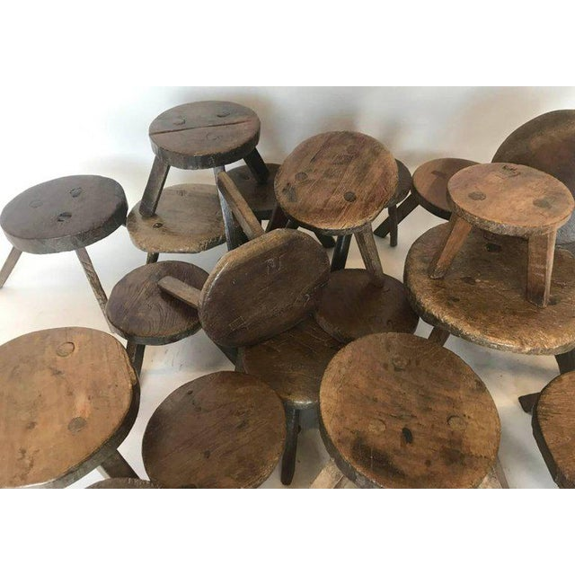 A collection of antique, 19th century wooden milking stools in various sizes. Price varies, from $255 - 550 each. This...