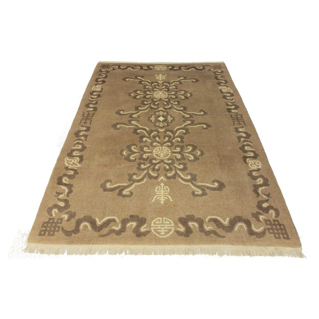 Vintage one-of-a-kind hand-knotted wool area rug from Tibet. Simple but beautiful design with shades of brown and ivory.